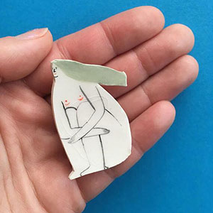 Sesame Drawing Club Exhibition image - ceramic woman brooch by Georgie Ellen McAusland